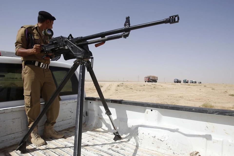 An Iraqi soldier monitored a highway west of Karbala on Sunday.