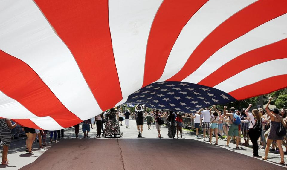 Members of the Gay, Lesbian and Bisexual Veterans Association carried a big US flag in Chicago.