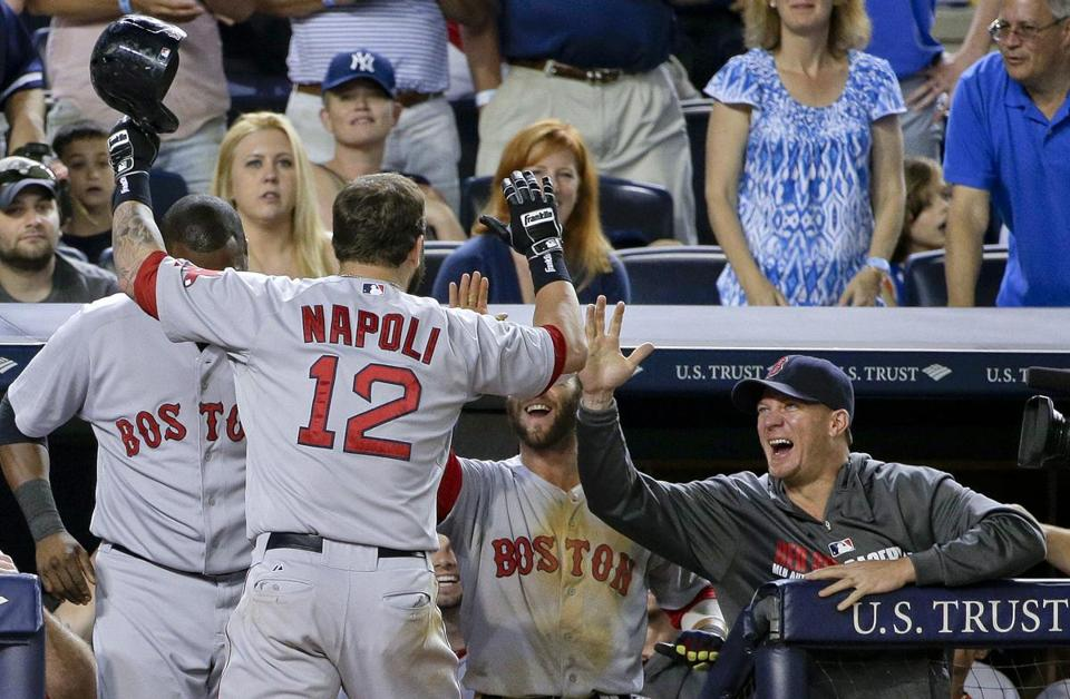 Mike Napoli returned to a happy Red Sox dugout after hitting a solo home run in the ninth inning.