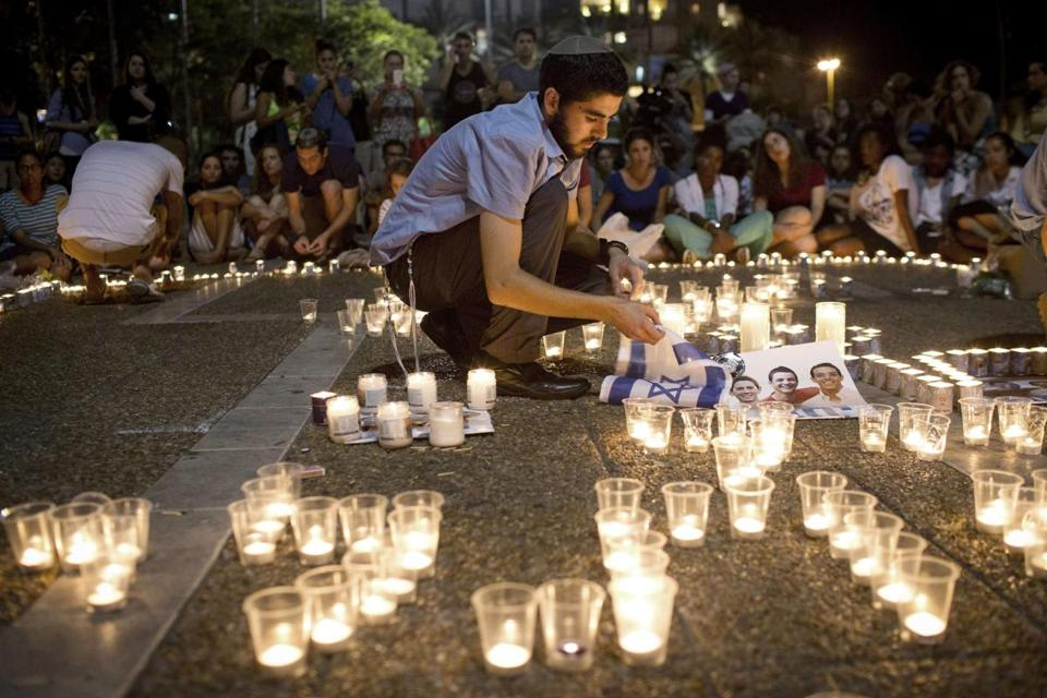 Mourners lit candles in Rabin Square in Tel Aviv after it was announced the bodies of three missing Israeli teenagers had been found.