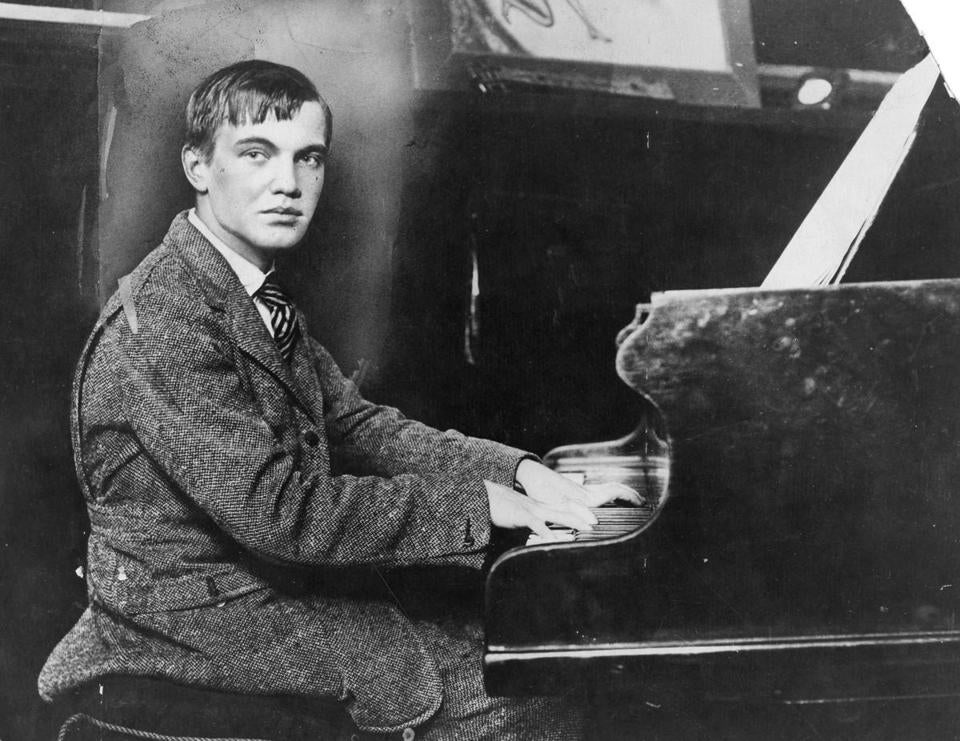 "George Antheil (top, in January 1928) created the music for ""Ballet Mécanique"" from airplane propellers, electric bells, a siren, and a phalanx of unmanned player-pianos. Gil Rose (right) and the Boston Modern Orchestra Project released a recording of it earlier this year."