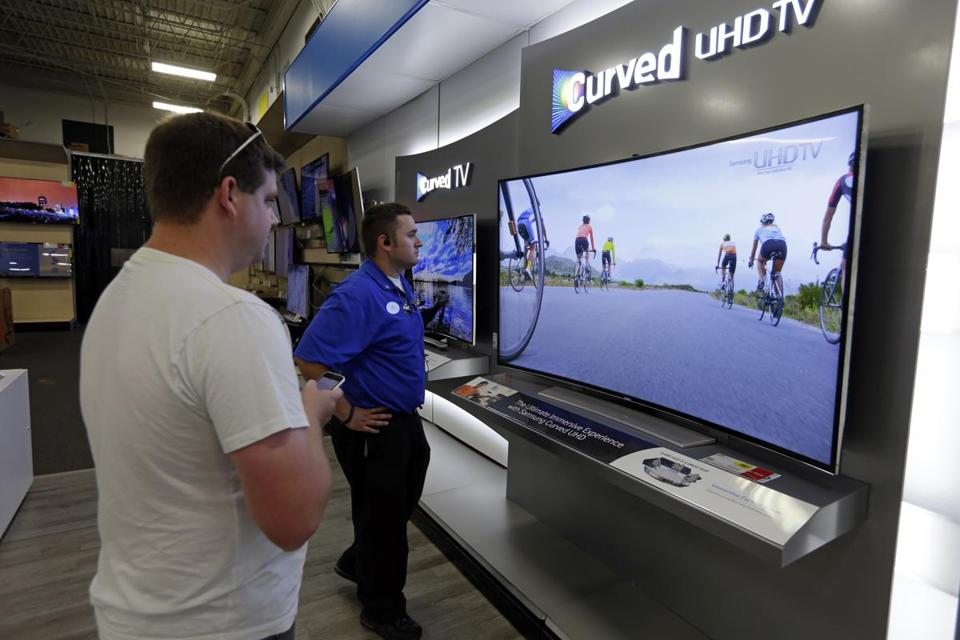 Sales of larger TVs have risen 50 percent in the last year, and technology like curved screens is catching on.