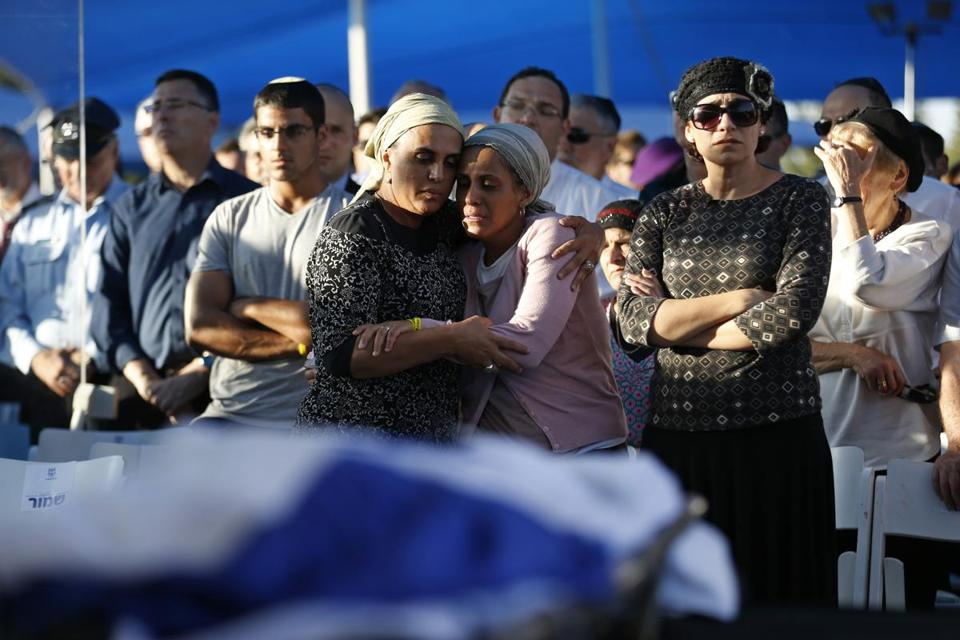 Bat-Galim Shaar (front right), and Iris Yifrach (front second right), mothers of two of the  Israeli teens abducted and killed, mourned during the joint funeral of their sons Tuesday.