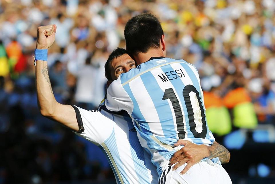 Argentina's Angel Di Maria (left) scored the game-winning goaloff a pass from Lionel Messi.