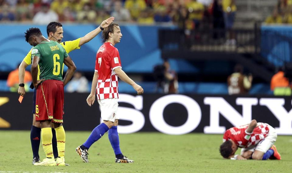 Cameroon lost, 4-0, to Croatia June 18, and Cameroon's Alex Song (6) was given a red card. Themba Hadebe/Associated Press