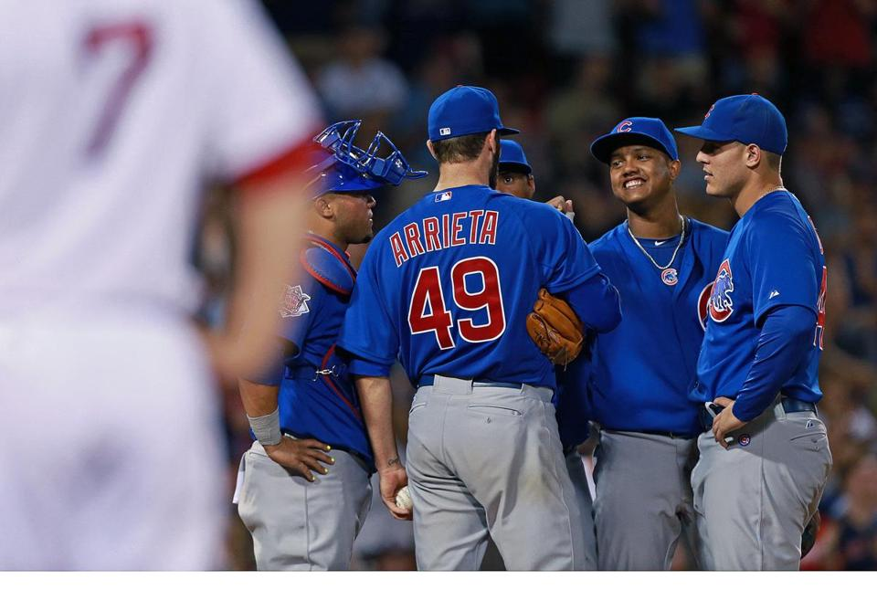 Teammates converged on Jake Arrieta after Stephen Drew (7) broke his no-hit bid in the eighth inning.