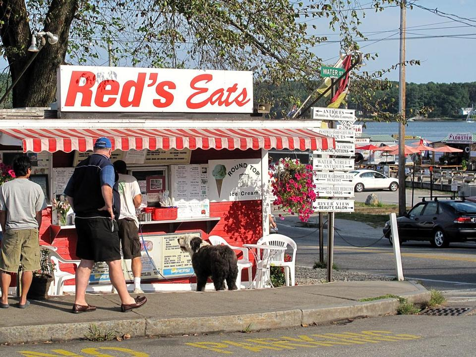 On Route 1 in Wiscasset, Red's Eats has a national reputation and a hot dog among its patrons (with Sprague's Lobster in the background across the highway).