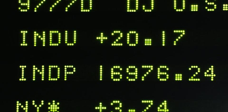 A board at the New York Stock Exchange shows the closing number for the Dow Jones industrial average.