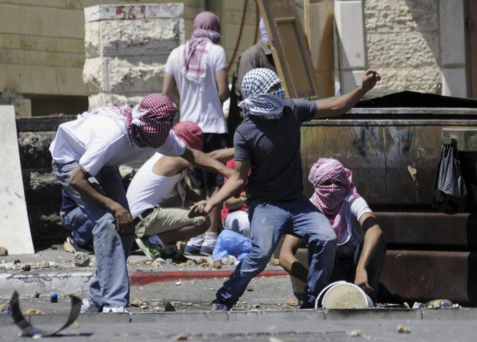 Palestinians threw stones during clashes with Israeli border police in Jerusalem.