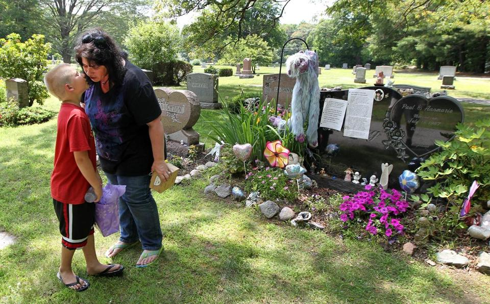 Annmarie Schieding and grandson Skyler, 8, visited Stephanie Schieding's grave Wednesday.