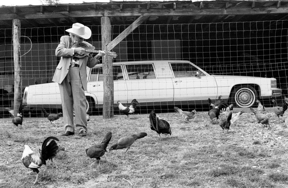 """He was playing this song called 'The Chicken Reel,' and all these chickens started hanging around him. I originally wanted to back his limousine from out in front of his cabin, but it wouldn't start, and there were two bales of hay in the back,"" Marty Stuart, laughing, on his 1995 shot of bluegrass legend Bill Monroe."