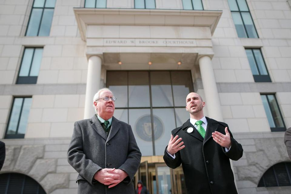 State Representatives Jim Lyons (left) and Marc Lombardo, here speaking in March to Justina Pelletier supporters, recently laid out seven objections to the state budget.