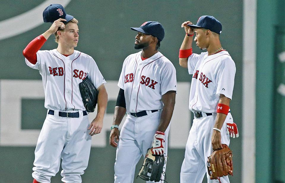 Brock Holt (left) is one rookie who has been hitting well for the Red Sox this season, but he's experienced at 26. Younger rookies  Jackie Bradley Jr. (center) and Mookie Betts have struggled so far at the plate.