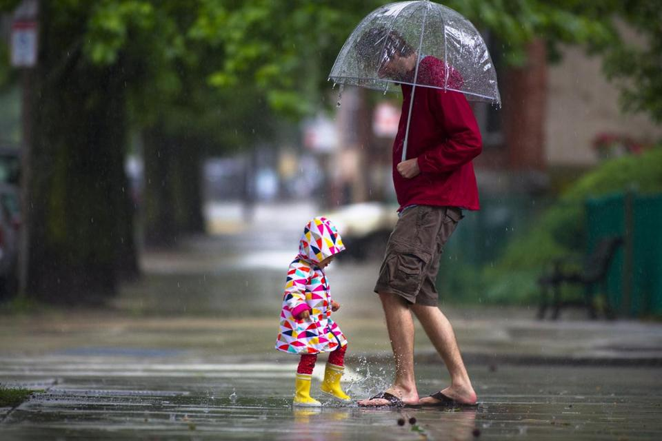 Parker Lippitt, 2, took dad Andy Lippitt on a puddle-jumping tour of Charlestown to make the most of stormy weather.