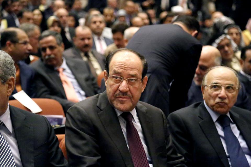 Iraqi Prime Minister Nouri al-Maliki, center, attended the first session of Parliament in Baghdad on Tuesday.