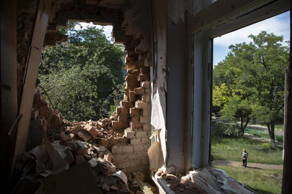 A school was damaged as government forces shelled Kramatorsk in eastern Ukraine.