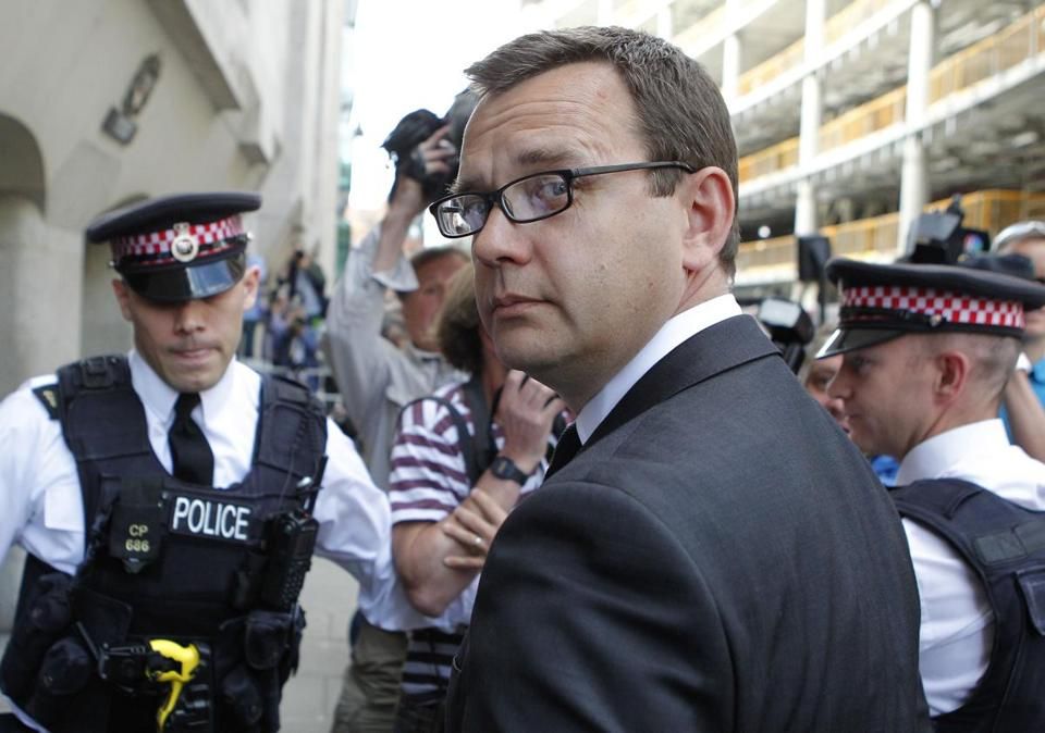 Andy Coulson, former editor of the News of the World, was sentenced to 18 months in a phone-hacking scandal.