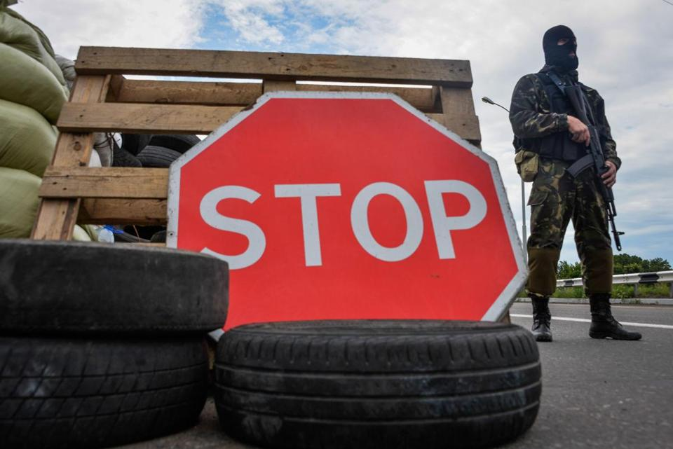 A pro-Russia fighter guarded a checkpoint close to Donetsk, eastern Ukraine's largest city, on Sunday.