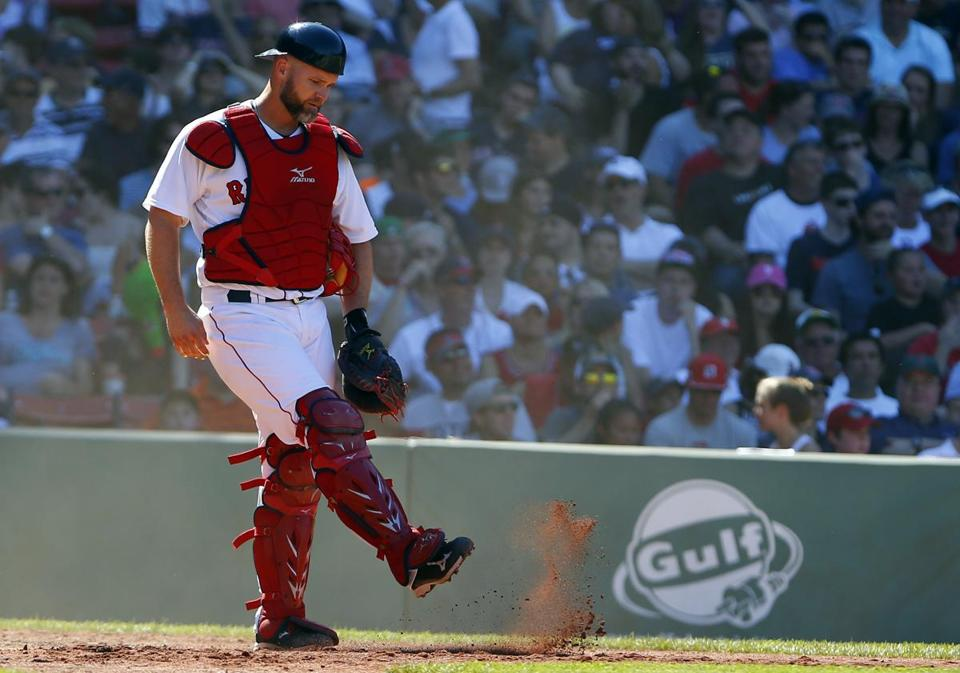 Red Sox catcher David Ross reacted after the Orioles' Nelson Cruz scored a run.