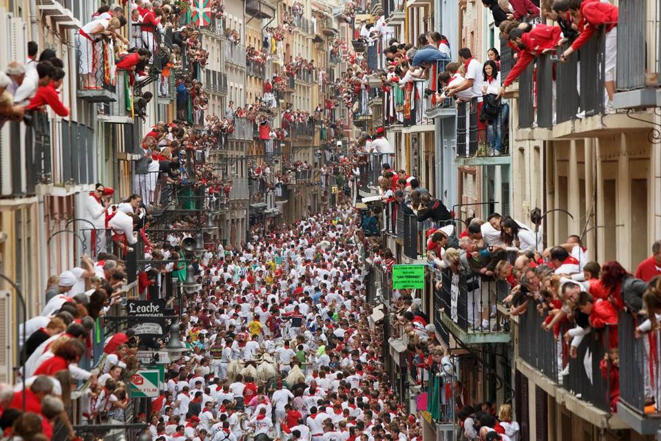 Revellers ran with fighting bulls along the Calle Estafeta during the second day of the Running Of The Bulls festival in Pamplona, Spain.