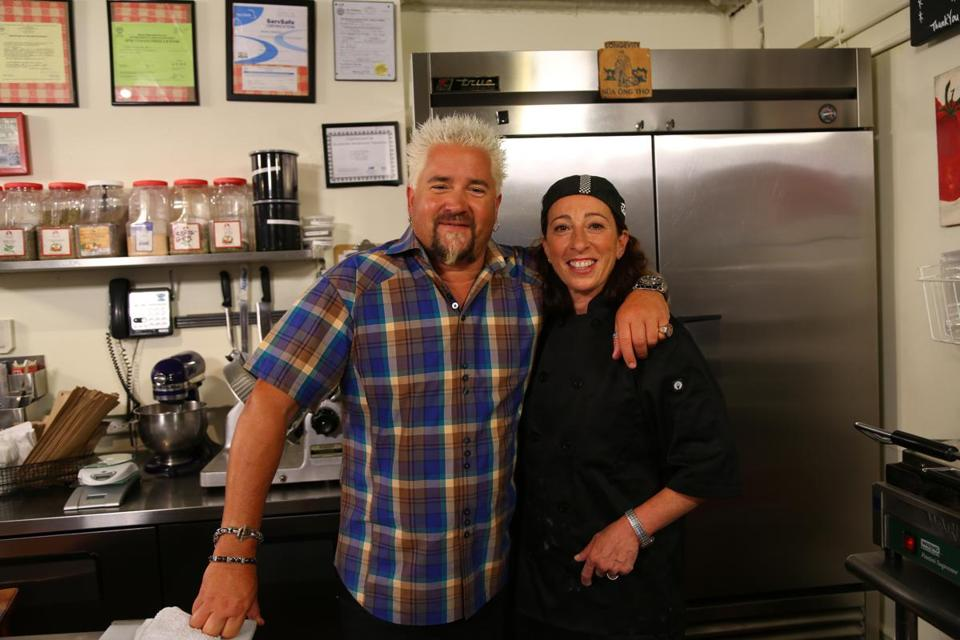 "Guy Fieri, host of the Food Network's ""Diners, Drive-Ins & Dives,"" and Nikki Christo, owner of Blunch, a South End sandwich cafe being featured on the show."