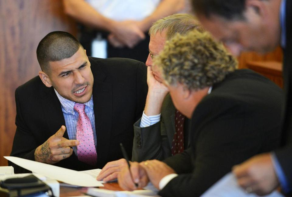 Aaron Hernandez speaks with his lawyers his lawyers, Charles Rankin and Michael Fee.