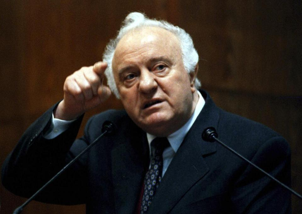 Eduard Shevardnadze gestured during a news conference in 1998.