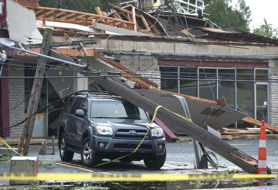 A shopping plaza in Grand Rapids, Mich., was heavily damaged by a storm packing winds of 80 miles per hour.