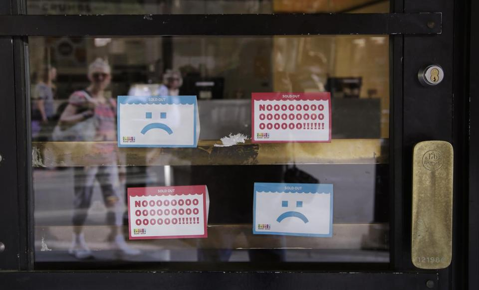 "The Crumbs cupcake shop on Federal Street in Boston was shuttered Tuesday. The chain, which opened a decade ago after the TV series ""Sex and the City"" made the confection popular, closed all its shops after being delisted from Nasdaq."