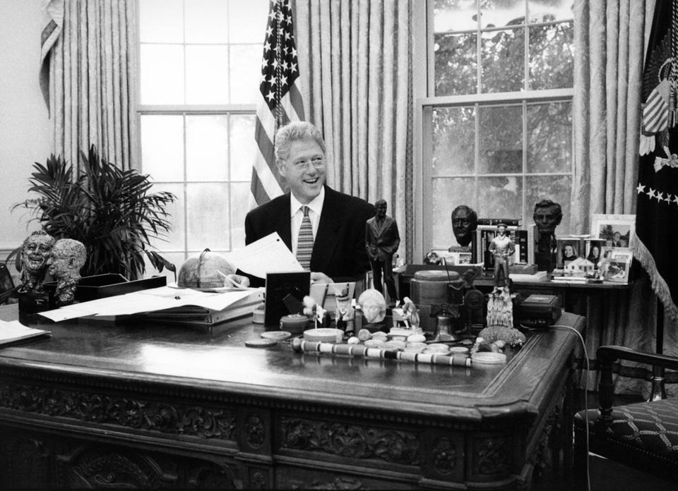 President Clinton sits at his desk in the Oval Office in 1996, the same year he signed the Defense of Marriage Act.