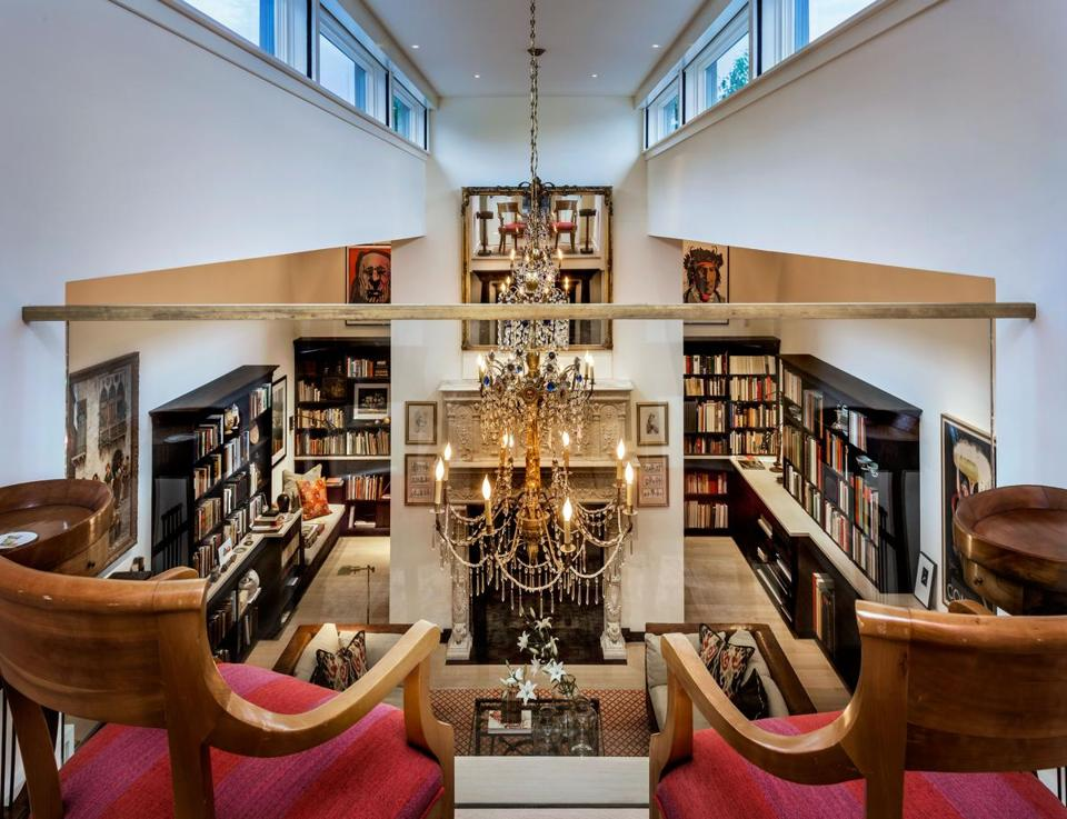 The glass-front balcony overlooking the Two Ponds library gives it an operatic feel, a theatricality magnified by the Tuscan festival lights and reproduction Renaissance marble fireplace.