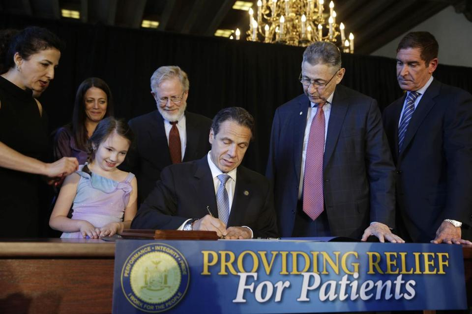New York officials and medical marijuana advocates joined Governor Andrew Cuomo for Monday's signing ceremony.