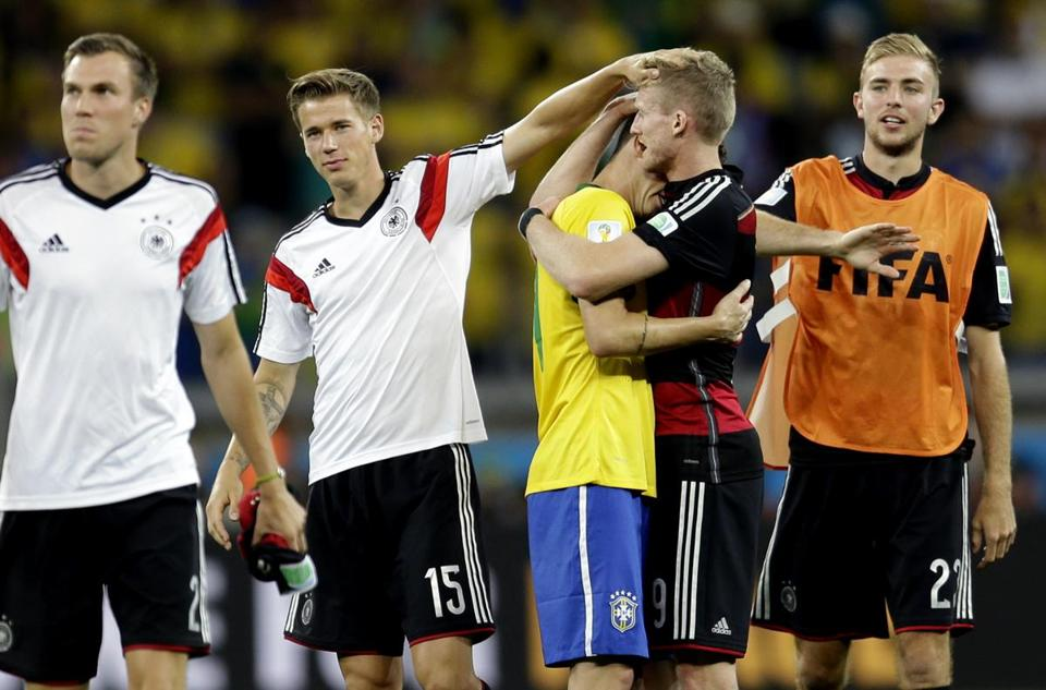 Brazil's Oscar (center) was consoled by Germany's Andre Schuerrle after Germany defeated Brazil 7-1.