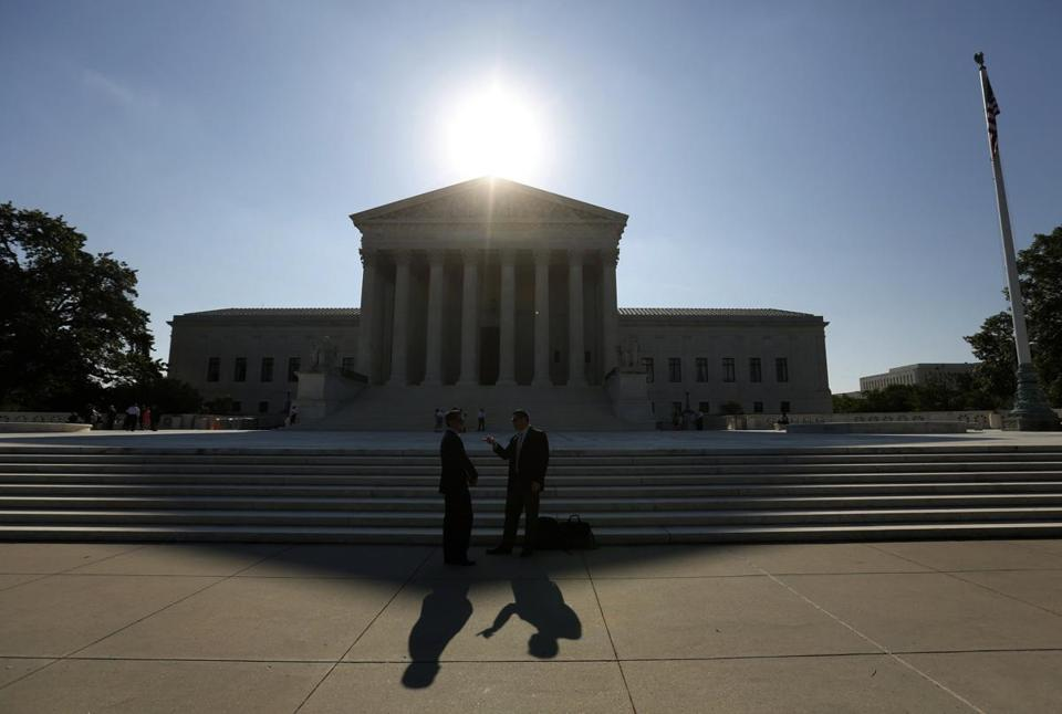The Supreme Court says the difference between their buffer zone and the one knocked down in Massachusetts is a distinction between a government plaza and a public sidewalk.