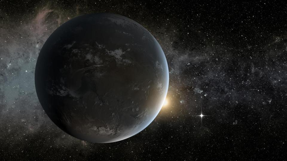 An artist's concept depicts NASA's Kepler misssion's smallest habitable zone planet. Seen in the foreground is Kepler-62f, a super-Earth-size planet in the habitable zone of a star smaller and cooler than the sun, located about 1,200 light-years from Earth in the constellation Lyra.