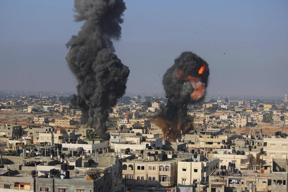 Smoke and flames are seen following what police said was an Israeli air strike in Rafah in the southern Gaza Strip.