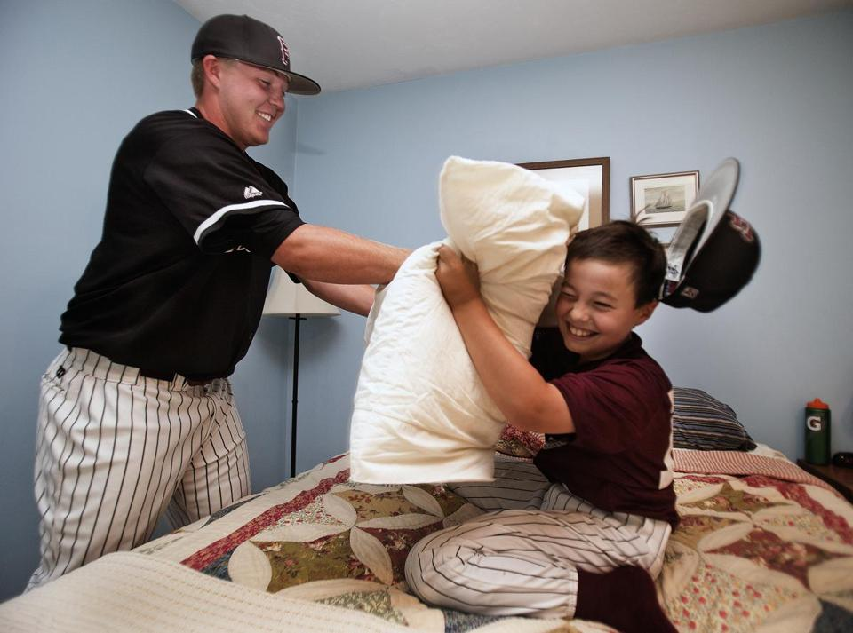 Falmouth Commodores Garrett Cleavinger has a pillow fight in his bedroom with batboy Anderson Uhl.