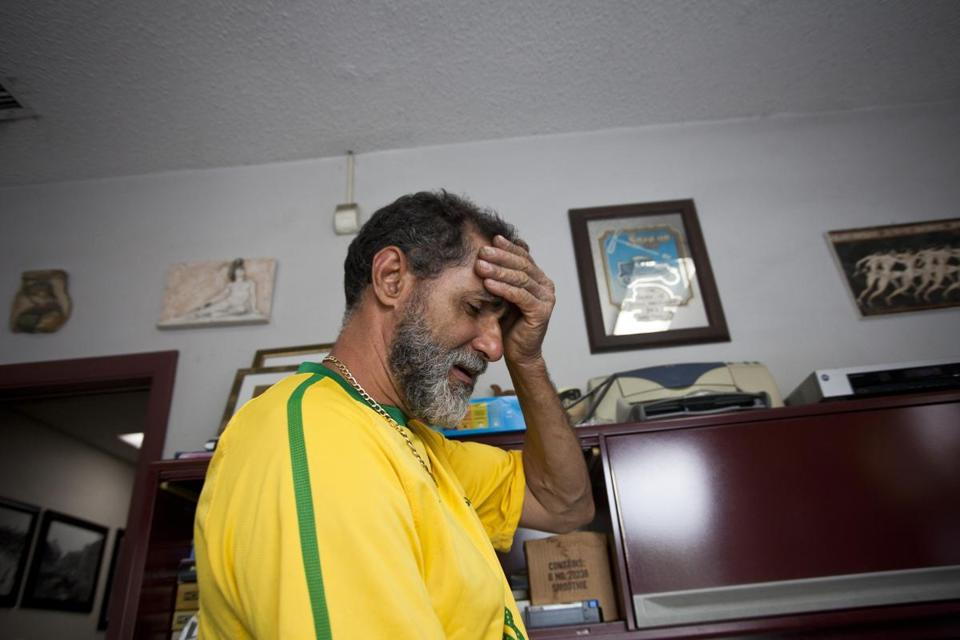 Brazil's loss to Germany took its toll on shop worker Santo, who put on the colors of his home country.