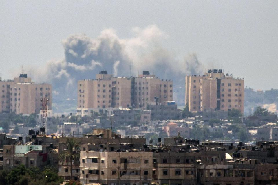 A picture taken from the southern Israeli Gaza border shows smoke billowing from buildings following an Israeli air strike in Gaza City.