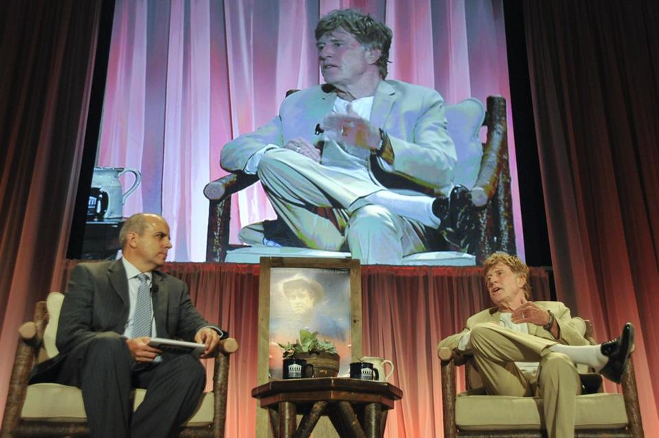 Patrick Cook, executive director of public affairs at Middlesex Commmunity College, interviewed Robert Redford as part of the college's celebrity forum Wednesday night.