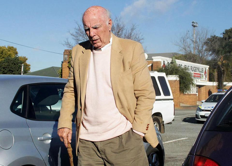 Disgraced former tennis star Bob Hewitt walks outside a court in Boksburg, South Africa on Friday.