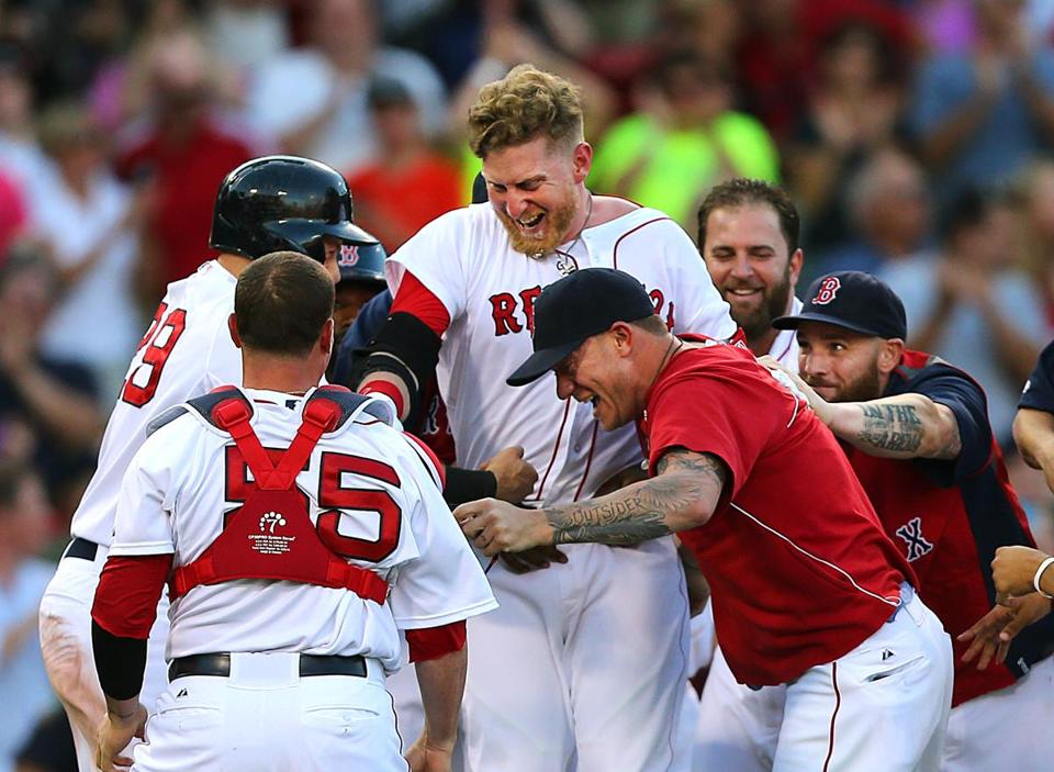 Mike Carp (center) was congratulated by his fellow Red Sox after their walkoff win.