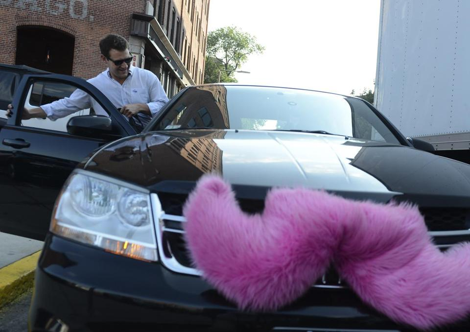 Lyft vehicles are known for the pink mustache they carry on their front grille.