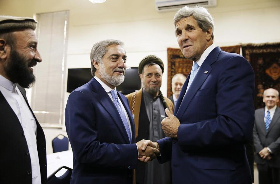 Secretary of State John Kerry shook hands with Afghan presidential candidate Abdullah Abdullah at the start of a meeting at the US Embassy in Kabul Friday.