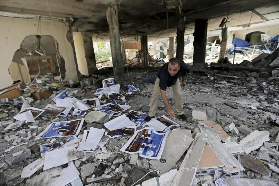 A man searched the rubble of a center for disabled in Gaza after an Israeli missile strike.