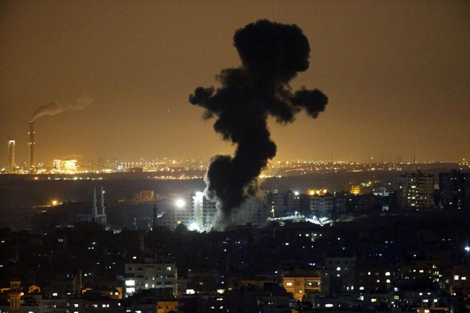 Smoke billowed following an Israeli airstrike in Gaza City.