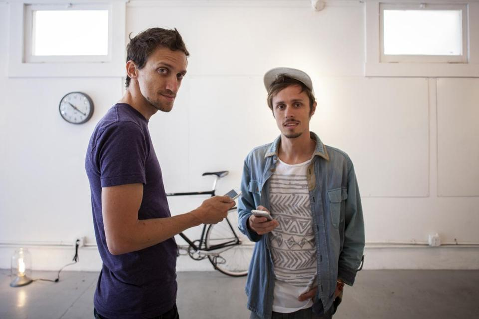 Paul McKellar (left) and Beamer Wilkins's Wut app lets people communicate without unlocking their phones.