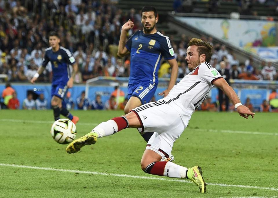 Germany's Mario Goetze shoots to score a goal against Argentina during extra time.