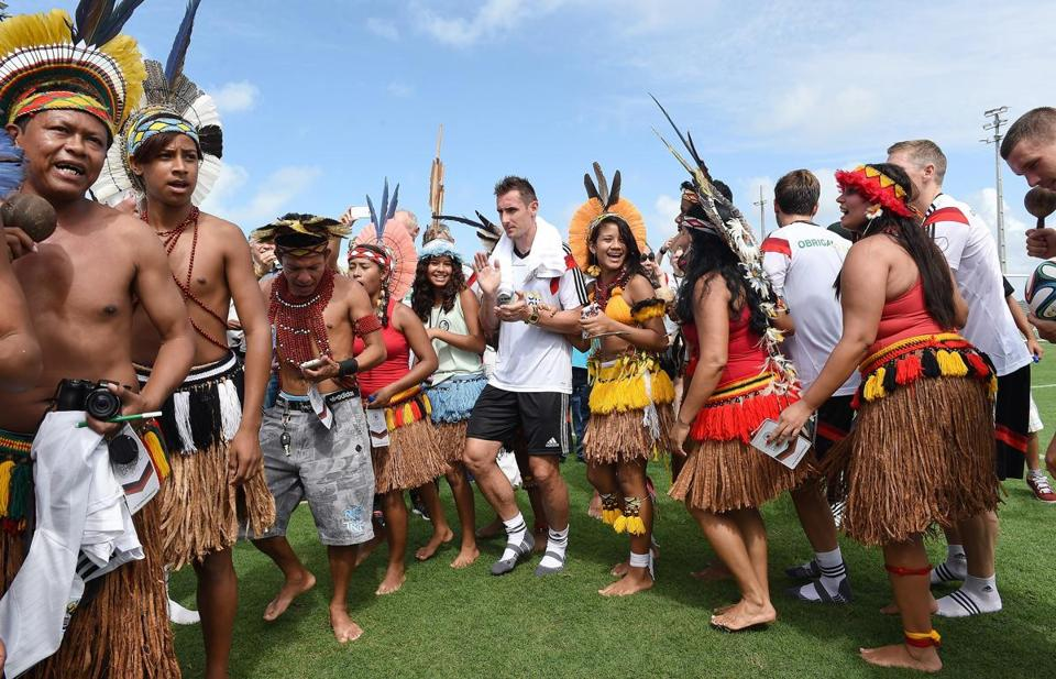 SANTO ANDRE, BRAZIL - JUNE 09: Miroslav Klose (C), dance with Brazilian indigenous after the German National team training session at Campo Bahia on June 9, 2014 in Santo Andre, Brazil. (Photo by Markus Gilliar - DFB Pool/Bongarts/Getty Images) (Photo by Pool/Bongarts/Getty Images)