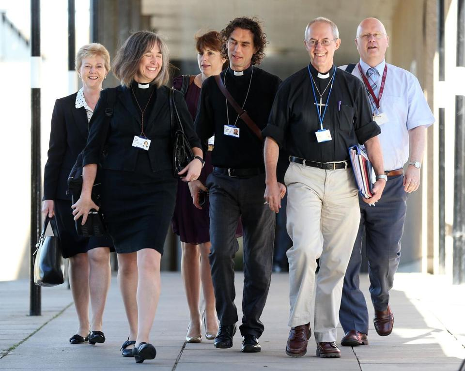 Archbishop of Canterbury Justin Welby (second from right) and unidentified members of the clergy arrived for the General Synod meeting at The University of York on Monday.